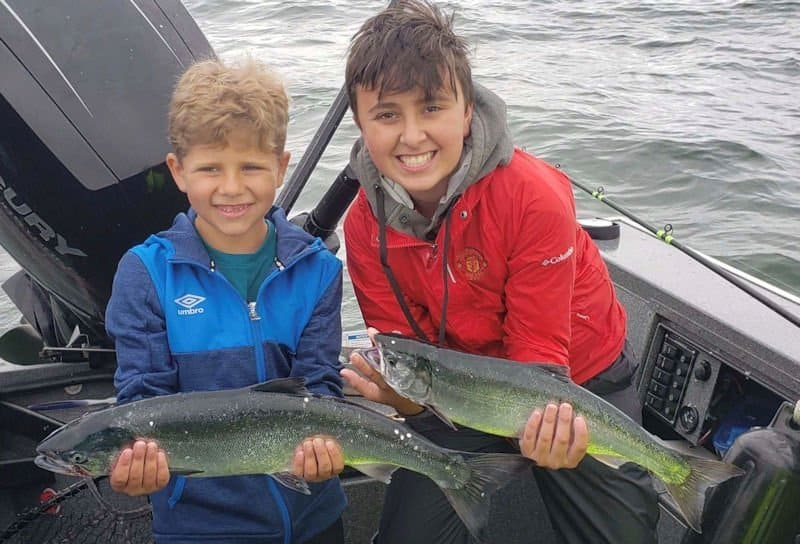 Alex Padilla, 7 of New Mexico and Nate McDougal, 12 of Portland with a pair of hatchery coho off of the mouth of the Columbia River from July 15th.